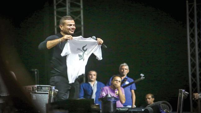 """بالفيديو.. عمرو دياب يطرح أغنية """"عمرنا ما هنرجع زى زمان"""""""
